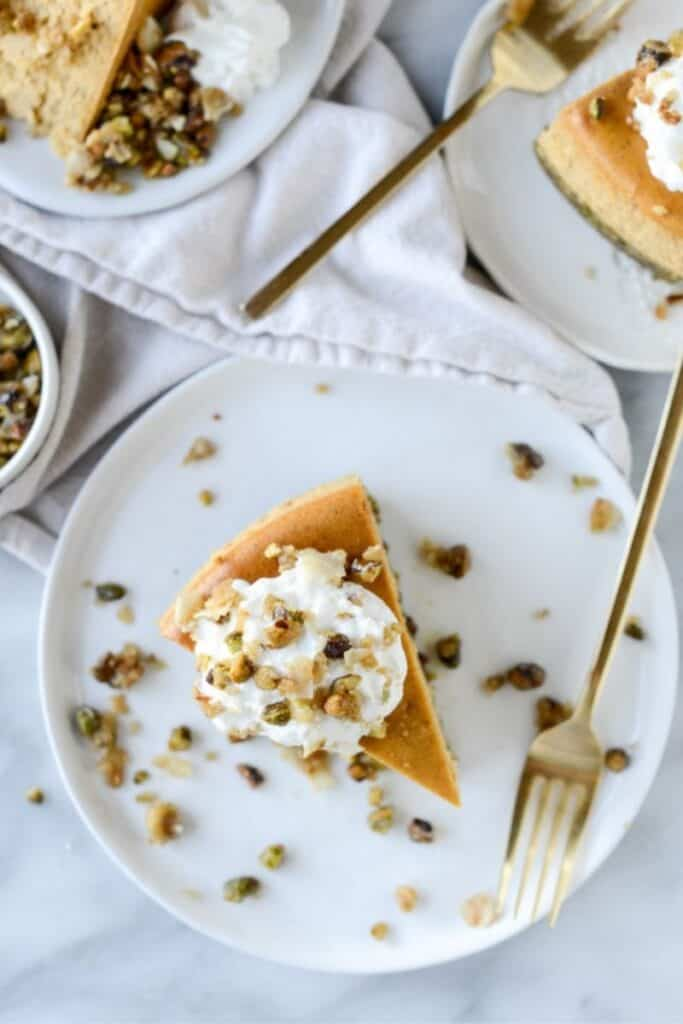Brown Sugar Pumpkin Cheesecake with Pistachio Macaroon Crust by How Sweet Eats