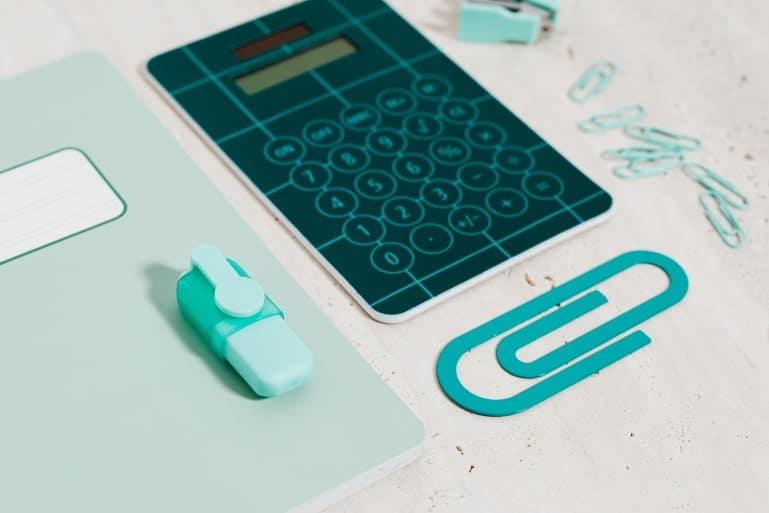 Calculator, notebook for saving money