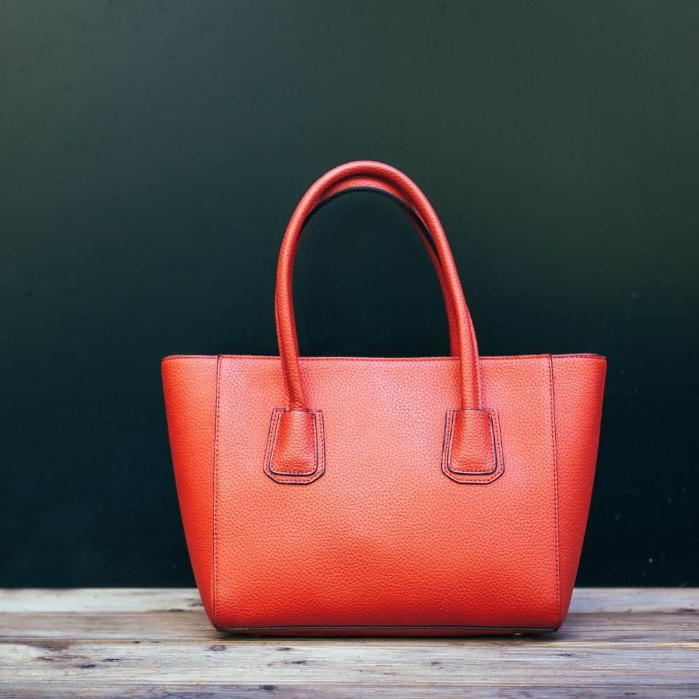 Why It's Bad Luck To Place Your Purse On The Floor